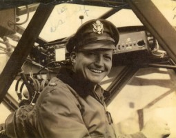 Photo of Maj. Walker in the cockpit of a Stinson L-5